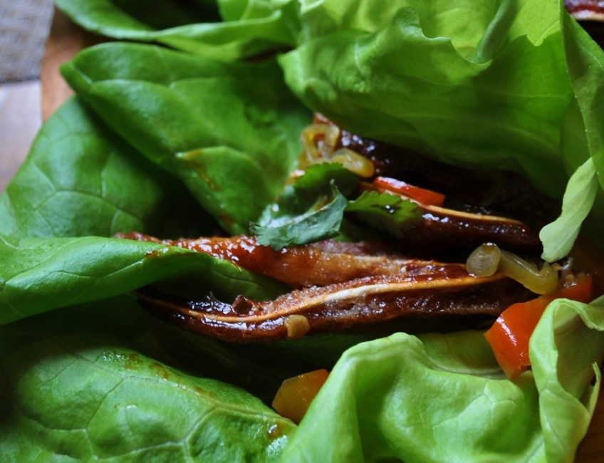 BBQ Pig Ear Lettuce Wrap with Pickled Peppers and Cilantro